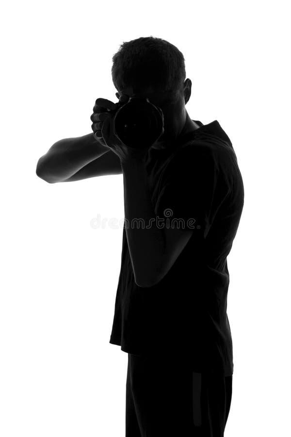 Zwart-witte foto van een mens die enthousiast in hun hobby in dienst nam en het volgende beeld maakt royalty-vrije stock fotografie