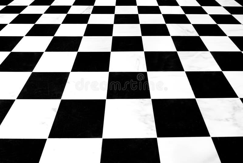 Zwart-witte geruite vloer stock fotografie