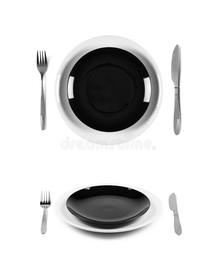 Zwart-witte platen met vork en mes royalty-vrije stock afbeeldingen