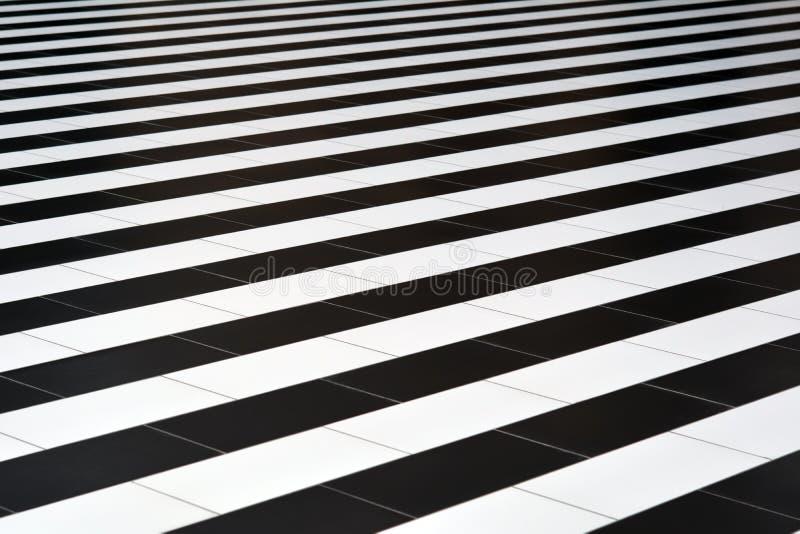 Zwart-witte tegels op de vloer royalty-vrije stock foto
