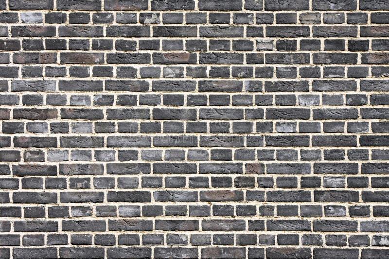 Zwarte bakstenen muur stock afbeelding