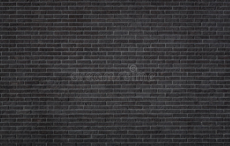 Zwarte bakstenen muurtextuur stock foto