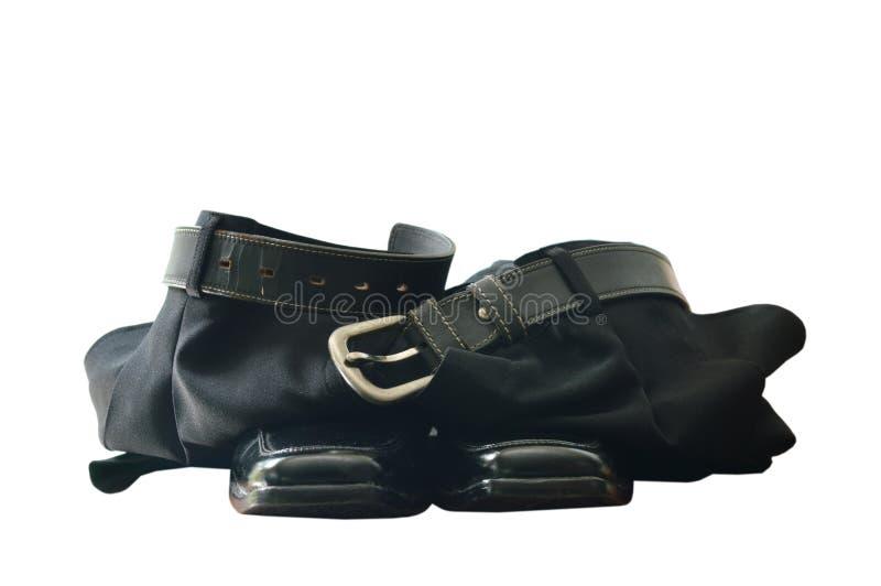 Zwarte bedrijfsbroek en schuimschoen op witte achtergrond royalty-vrije stock foto's