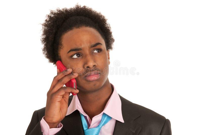 Zwarte bedrijfsmens met mobiele telefoon royalty-vrije stock afbeelding