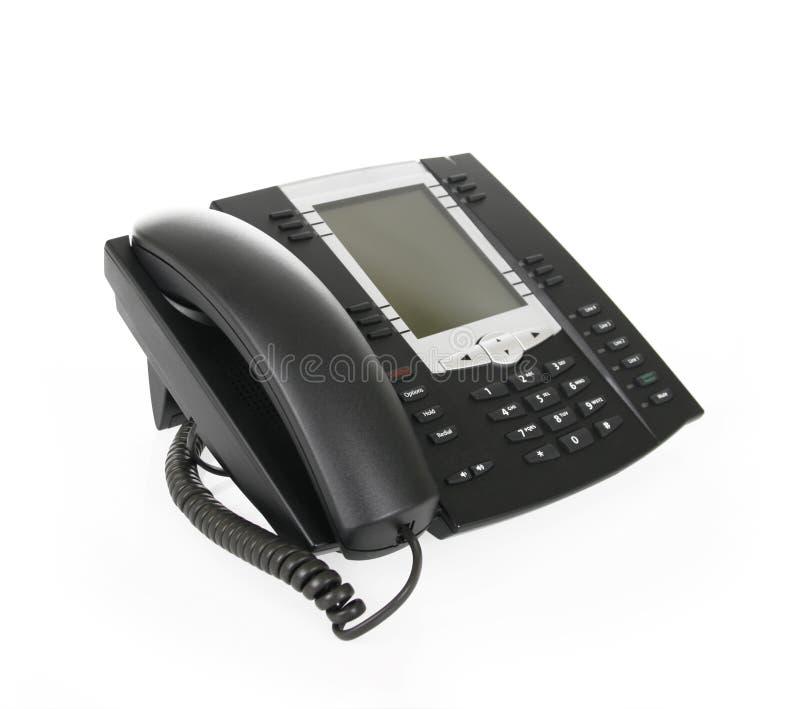 Zwarte bureautelefoon die op wit wordt geïsoleerde royalty-vrije stock afbeelding