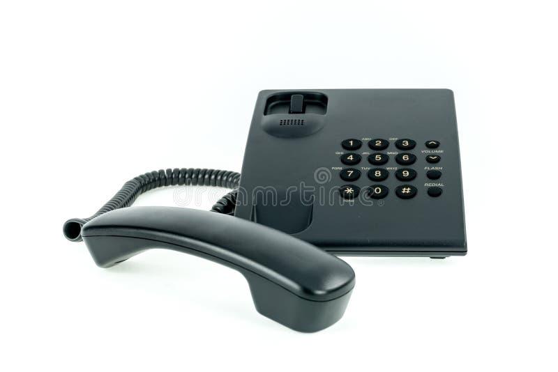 Zwarte bureautelefoon met dichtbij geïsoleerde zaktelefoon royalty-vrije stock foto
