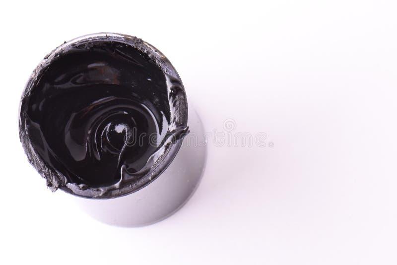 Zwarte de Geïsoleerde Kleur Open, volledige bak van zwarte verf Witte achtergrond stock fotografie