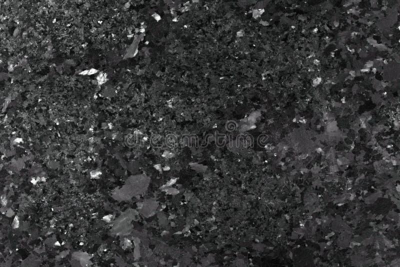Zwarte de rotstextuur van de graniet marmeren steen stock foto's