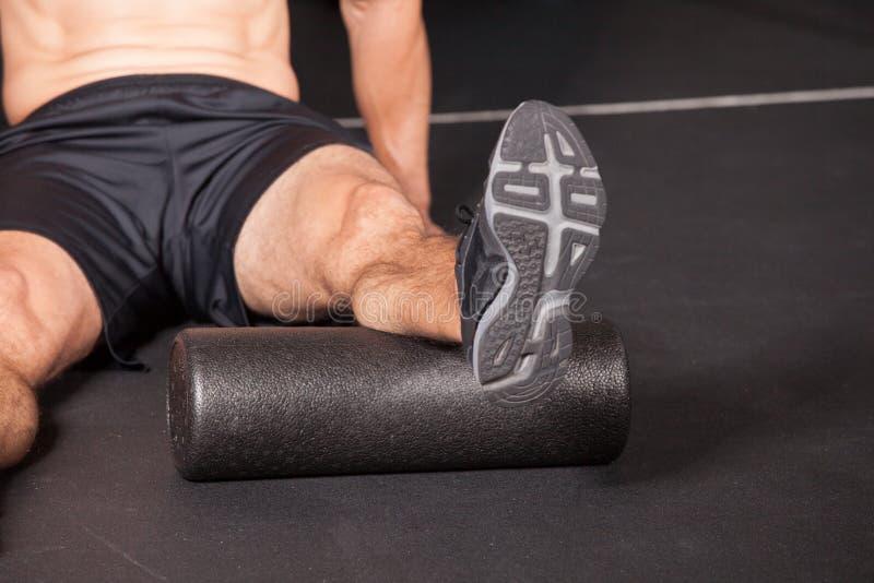 Zwarte de sportoefening van het massagebroodje stock foto