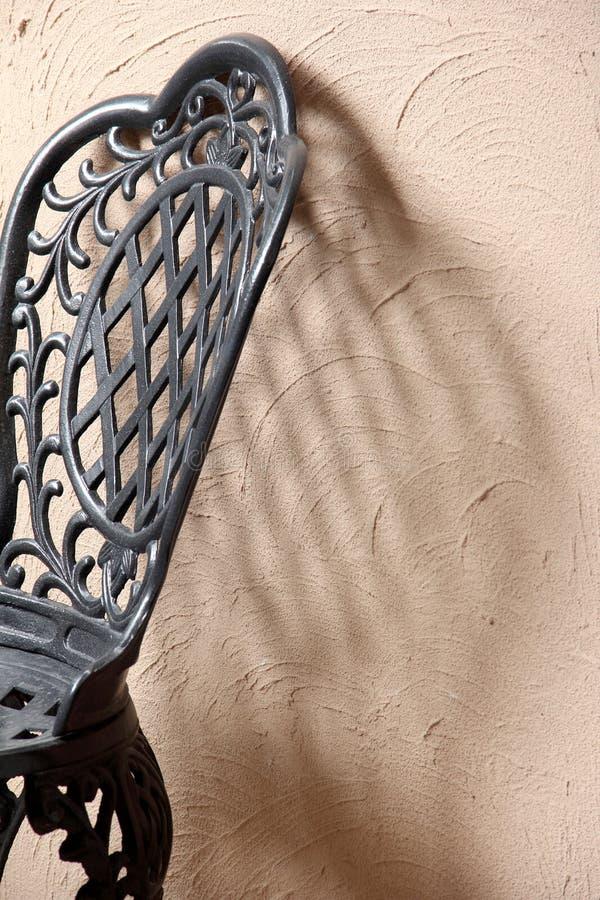Zwarte de textuurmuur van de ijzerstoel stock foto
