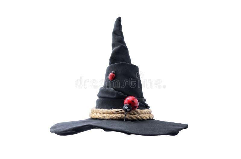 Zwarte die heksenhoed op witte achtergrond wordt geïsoleerd stock foto's