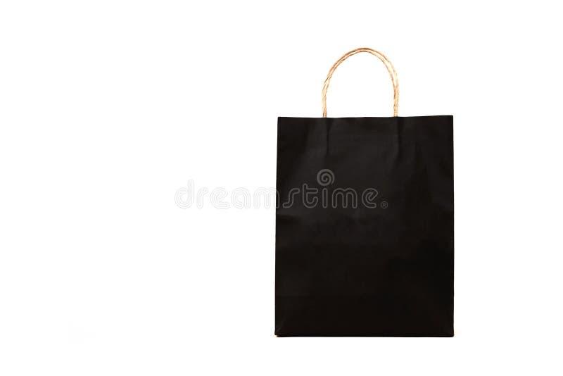 Zwarte document zak met handvatten op een witte achtergrond stock foto's
