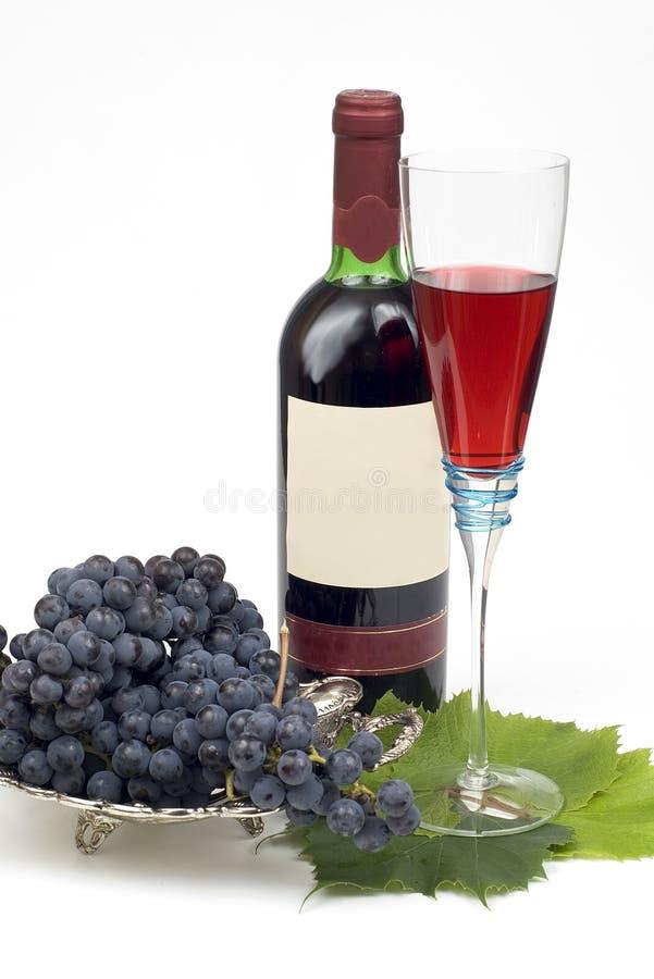 Zwarte druif en bottleful wijn 2 royalty-vrije stock foto