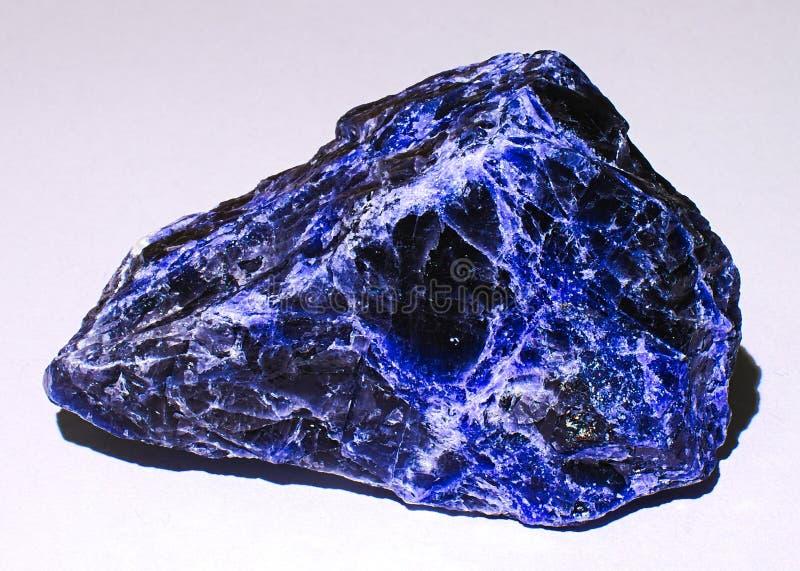 Zwarte en blauwe sodalite minerale steen royalty-vrije stock fotografie