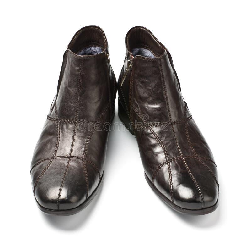 Zwarte en bruine mannelijke schoenen stock fotografie