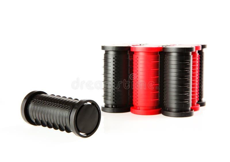 Zwarte en rode haarrollen stock afbeeldingen
