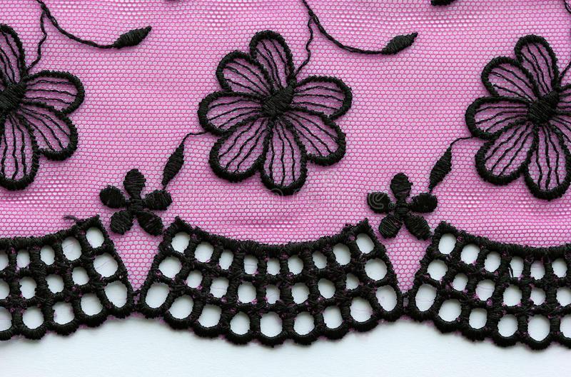 Zwarte en roze materiële de textuurmacro van het bloemenkant royalty-vrije stock afbeeldingen