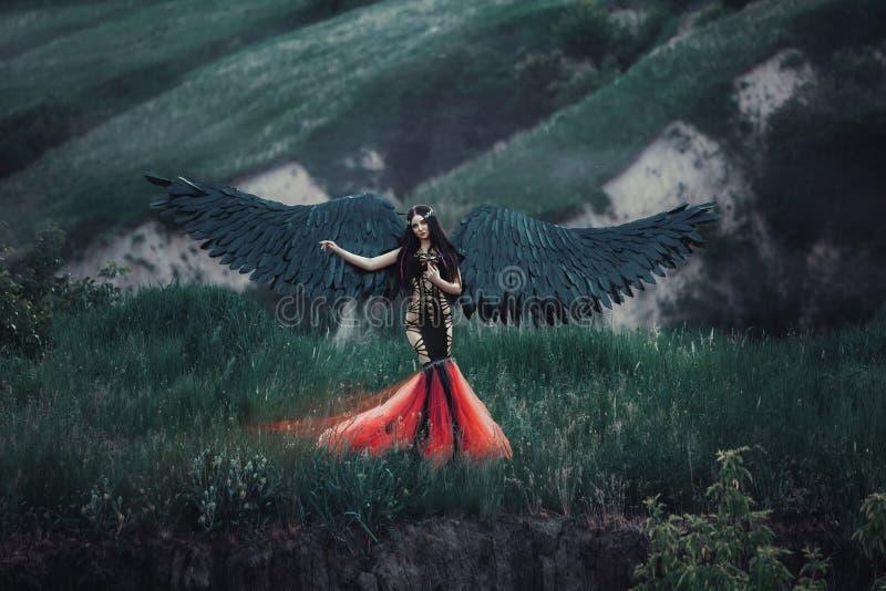 Zwarte engel Mooi meisje-demon royalty-vrije stock foto