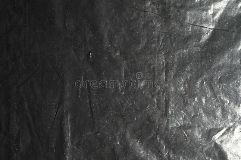 Zwarte folietextuur stock afbeeldingen