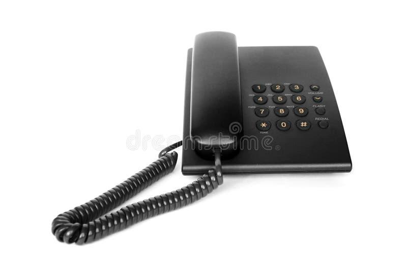 Zwarte geïsoleerder bureautelefoon royalty-vrije stock fotografie