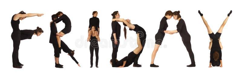 Zwarte geklede mensen die woordvrijdag vormen stock fotografie