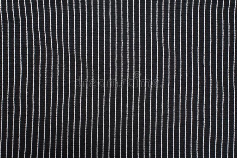 Zwarte geweven gebreide stof met witte strepen Verticaal patroon stock foto