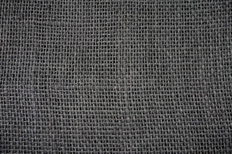 Zwarte Geweven Jutetextuur Als achtergrond stock afbeelding