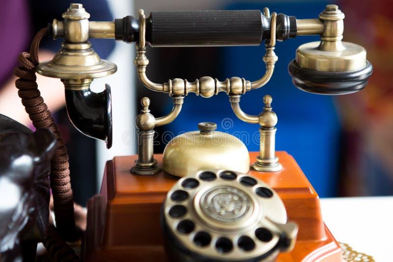 Zwarte gouden antieke uitstekende telefoon, samenvatting van mededeling royalty-vrije stock foto's