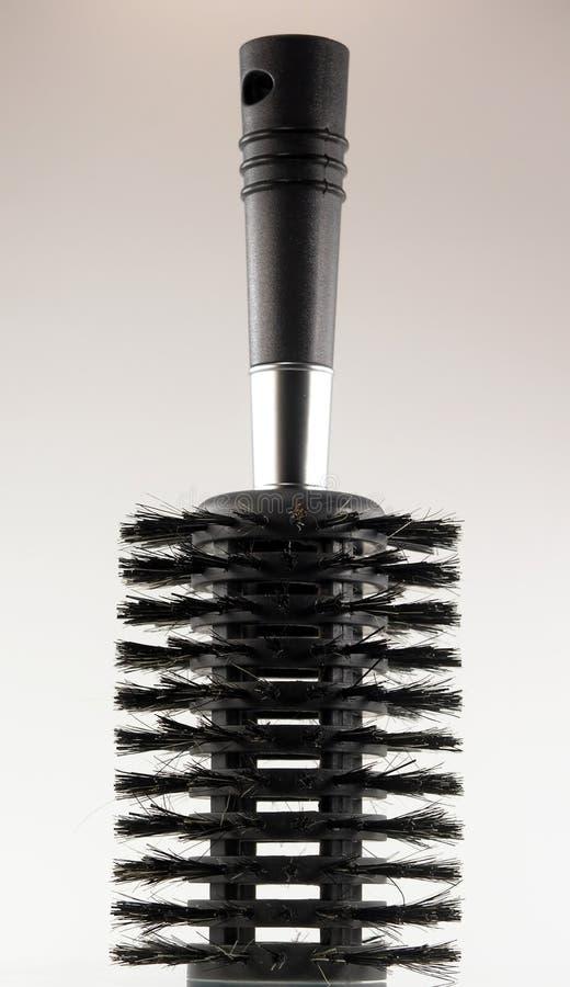 Zwarte haarborstel royalty-vrije stock afbeelding