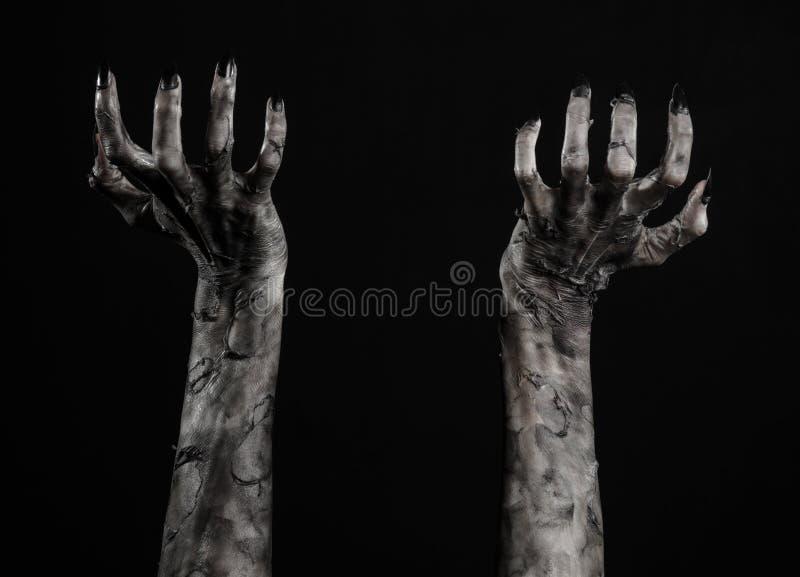 Zwarte hand van dood, volkomen het lopen, zombiethema, Halloween-thema, zombiehanden, zwarte achtergrond, brijhanden stock afbeeldingen
