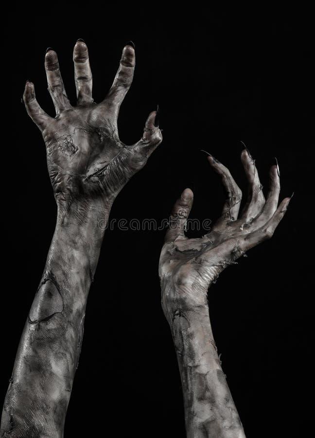 Zwarte hand van dood, volkomen het lopen, zombiethema, Halloween-thema, zombiehanden, zwarte achtergrond, brijhanden royalty-vrije stock afbeelding