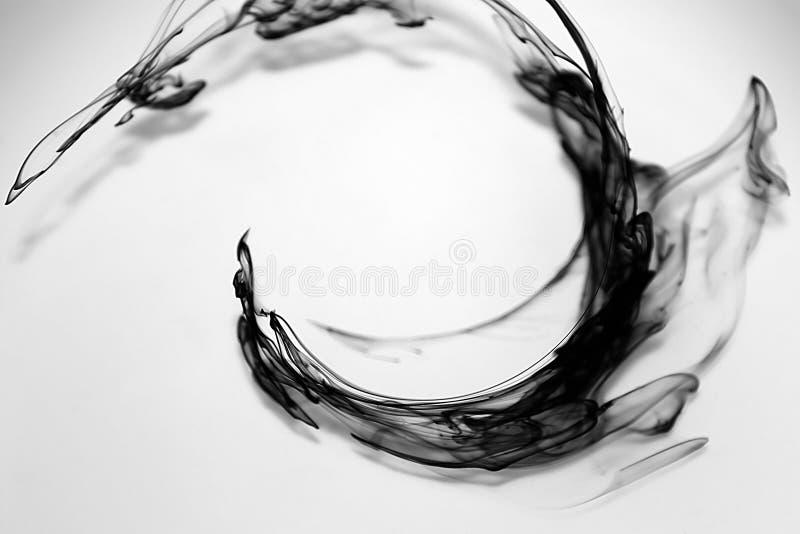 Zwarte inktdalingen royalty-vrije stock foto