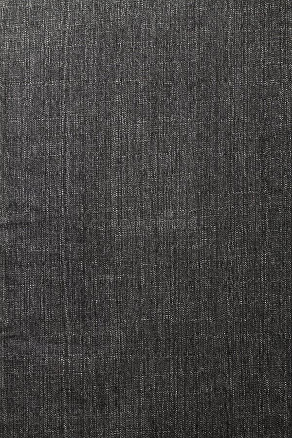 Zwarte jeans als achtergrond stock afbeeldingen