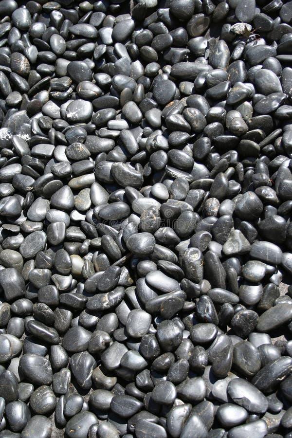 Zwarte kiezelstenenachtergrond royalty-vrije stock afbeelding
