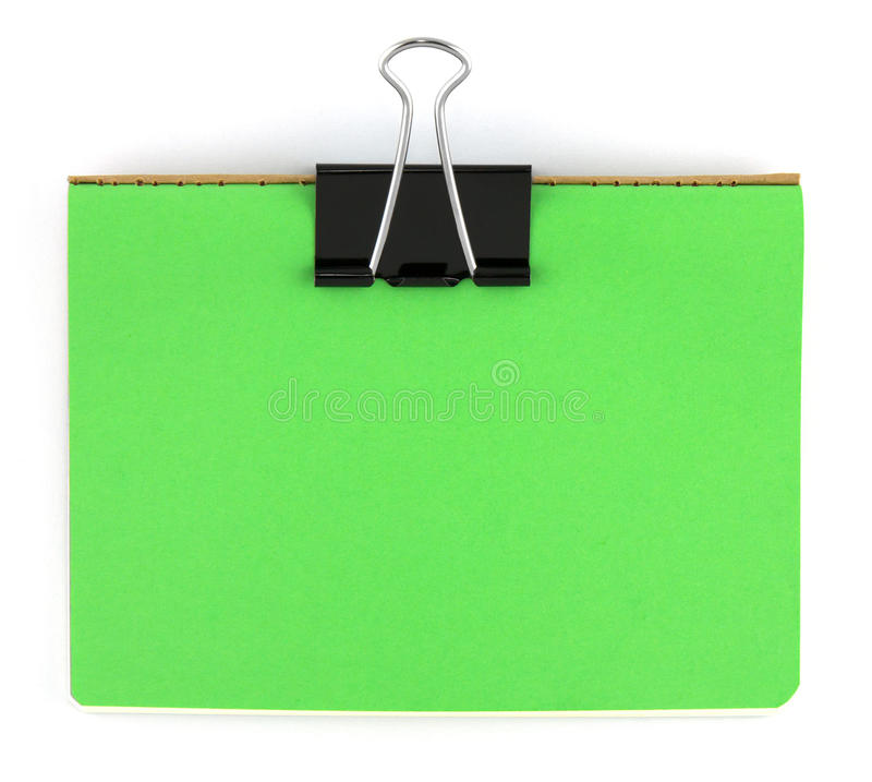 Zwarte klem en groen leeg notadocument stock fotografie