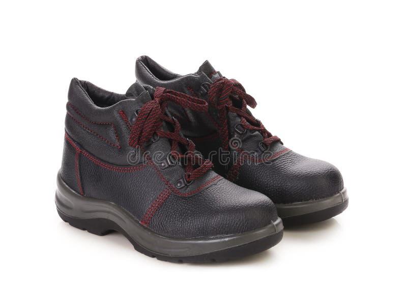 Zwarte laarzen met rood kant. stock afbeeldingen