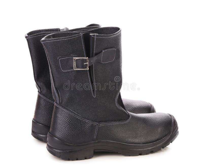 Zwarte leer hoge laarzen. stock foto