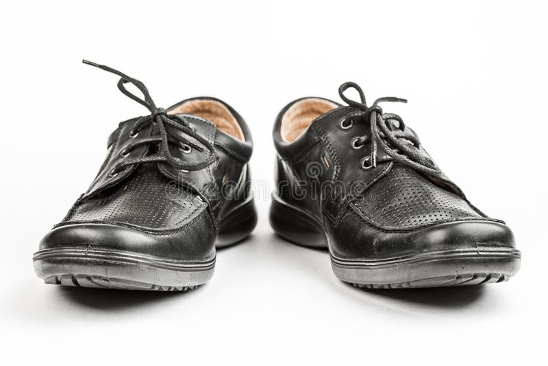 Zwarte leer mannelijke schoenen, witte achtergrond royalty-vrije stock foto