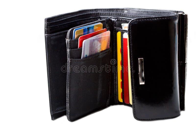 Zwarte leerportefeuille met geïsoleerde creditcards stock foto