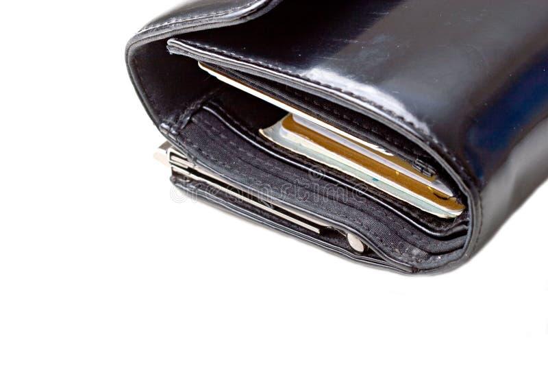 Zwarte leerportefeuille met geïsoleerdee creditcards royalty-vrije stock afbeelding