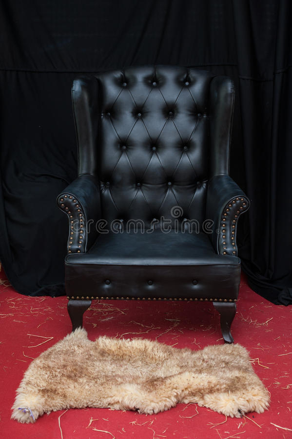 Zwarte leerstoel royalty-vrije stock afbeeldingen