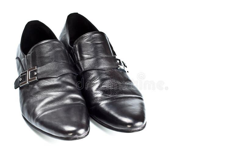 Zwarte mannelijke schoenen met gespen royalty-vrije stock foto's