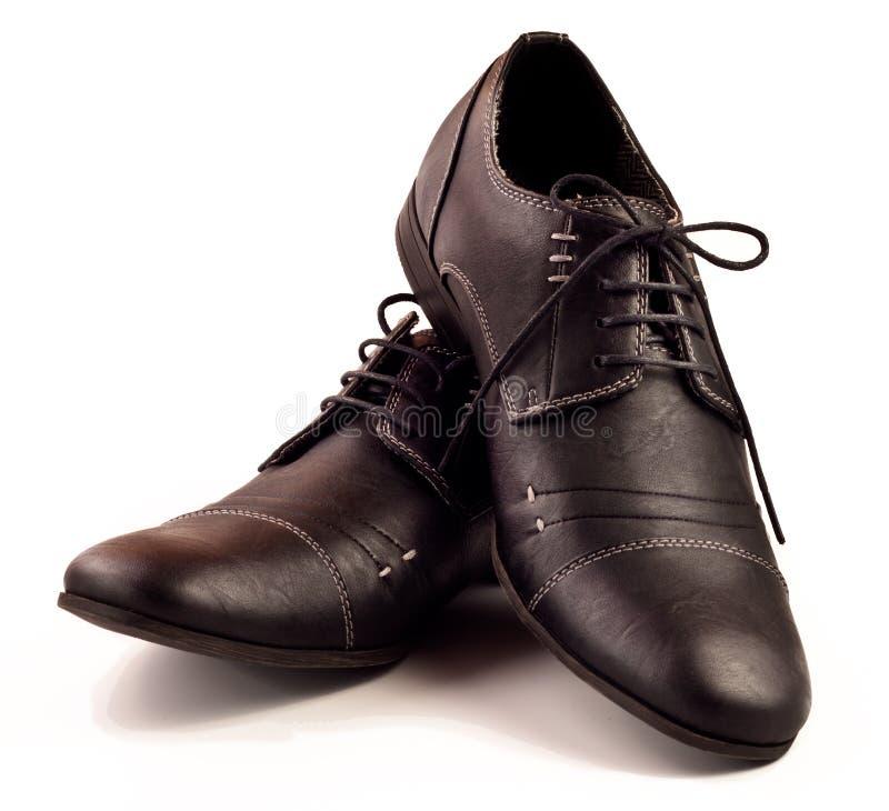 Zwarte mannelijke schoenen over wit royalty-vrije stock afbeelding