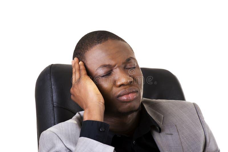 Zwarte mensenzitting op het werk stock fotografie