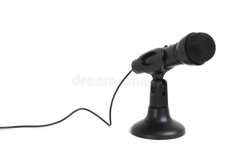 Zwarte microfoon op wit stock afbeelding