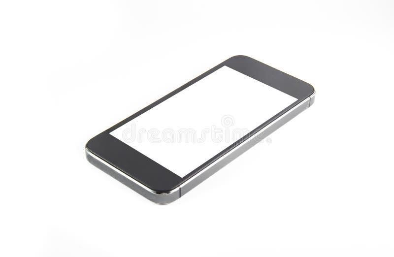 Zwarte moderne smartphone met het lege die scherm ligt op de oppervlakte, op witte achtergrond wordt geïsoleerd Geheel beeld in n stock fotografie