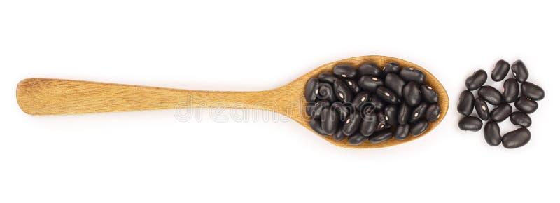 Zwarte nierboon in houten die lepel op witte achtergrond wordt geïsoleerd Hoogste mening Vlak leg royalty-vrije illustratie