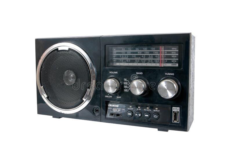 Zwarte oude die radio op witte achtergrond wordt geïsoleerd stock foto