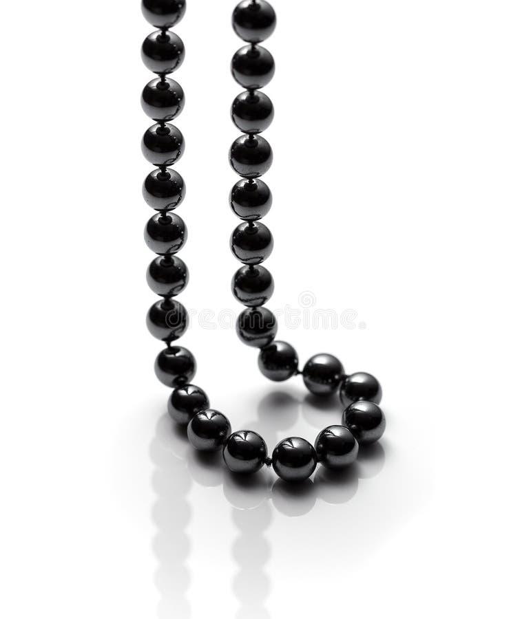 Zwarte parelhalsband stock afbeeldingen