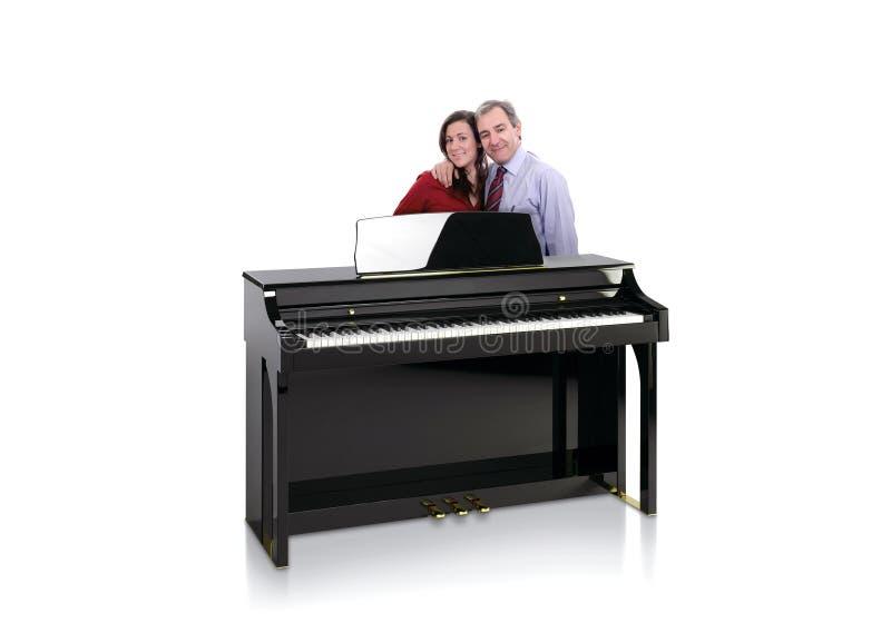Zwarte Piano met Gelukkig Paar royalty-vrije stock afbeeldingen